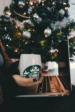 Laptop and coffee with Christmas tree Royalty Free Stock Photos