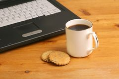 Laptop, Coffee and Cookies. Laptop keyboard with cup of coffee and cookies Royalty Free Stock Photo