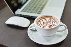Laptop with coffee cup Stock Image