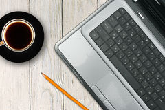 Laptop and coffee cup Stock Photos