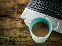 Laptop and coffee cup Royalty Free Stock Photography