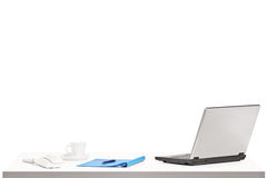 Laptop, coffee and other office objects on a table Royalty Free Stock Images