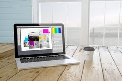 Laptop with graphic design software on screen with port backgrou. Laptop with coffee showing graphic design software on screen near the window. 3d Rendering Royalty Free Stock Photos