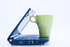 Laptop and coffee on top. Laptop with side view and a cup of coffee on it Stock Photo