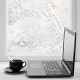 Laptop and coffee on winter window Royalty Free Stock Photo
