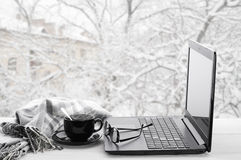 Laptop and coffee on winter window Stock Images
