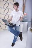 Laptop and cognac Stock Photos