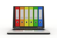 Laptop and colorful archive folders. Royalty Free Stock Image