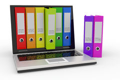 Laptop and colorful archive folders. Royalty Free Stock Photography