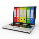 Laptop and colorful archive folders. Stock Images