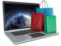 Laptop and colorful Shopping Bags. Online internet concept Stock Images