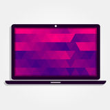 Laptop with colorful triangles Royalty Free Stock Images