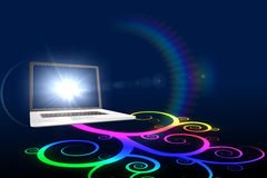 Laptop with colourful spiral design Royalty Free Stock Images