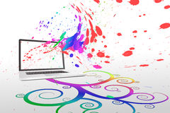 Laptop with colourful spiral design Stock Photos