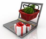 Laptop com cesto de compras festivo Imagens de Stock Royalty Free