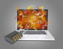 Laptop with combination lock emits colored smoke Royalty Free Stock Photos
