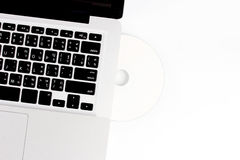 Laptop and compact disc Royalty Free Stock Photography