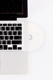 Laptop and compact disc Royalty Free Stock Photos