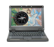 Laptop with compass and map Royalty Free Stock Photos