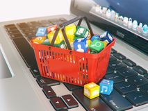 Laptop computer application software icons in the shopping baske. T. Store of apps concept. 3d illustration Stock Photos