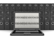 Laptop computer and audio speakers in background Royalty Free Stock Images