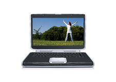 Laptop computer with a beautiful young girl alone. In the park, isolated in white Royalty Free Stock Photos