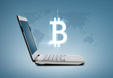 Laptop computer with bitcoin Stock Images