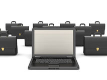 Laptop computer and black briefcases Stock Photography