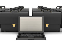 Laptop computer and black business briefcases Stock Photo