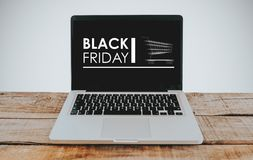 Laptop computer with Black Friday banner in the screen. Stock Photo