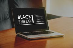 Laptop computer with Black Friday banner in the screen. Stock Image