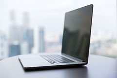 Laptop computer with black screen on office table Stock Images