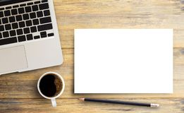 Laptop computer and blank paper,pencil with cup of coffee on woo royalty free stock photos