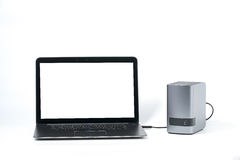 Laptop computer with a blank screen is connected to an external royalty free stock image