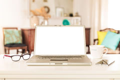 Laptop computer with blank screen in home interior royalty free stock images