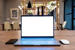 Laptop computer with blank white screen on table. Office concept royalty free stock photo
