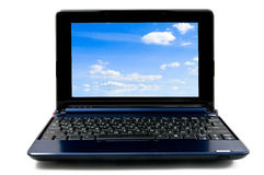 Laptop computer with blue cloudy sky wallpaper Royalty Free Stock Images