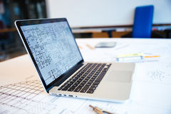 Laptop computer with blueprints on screen Royalty Free Stock Images