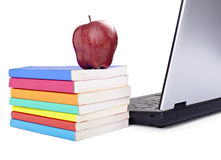Laptop computer books apple Royalty Free Stock Images
