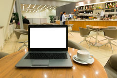 Laptop computer at café Royalty Free Stock Photo