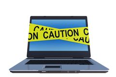 Laptop computer with caution tape around screen Stock Photo