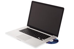 Laptop computer with CD Royalty Free Stock Image