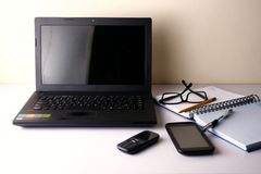 Laptop computer, cellphone, smartphone, notebook, pen, pencil and eyeglasses Royalty Free Stock Image