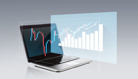 Laptop computer with chart on screen Stock Images