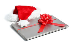 Laptop computer christmas gift with a ribbon Royalty Free Stock Image