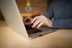 Laptop computer closeup of man browsing internet. Laptop computer cof man browsing internet. coffee time Stock Photos