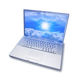 Laptop Computer Cloud Computing. A laptop computer isolated on a white background with a sunny image on the screen Royalty Free Stock Photography