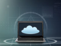 Laptop computer with cloud icon on screen Stock Photo