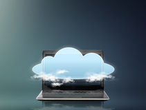 Laptop computer with cloud over screen Royalty Free Stock Photo