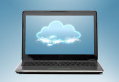 Laptop computer with cloud on screen Royalty Free Stock Images